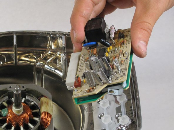 Remove the circuit board by lifting it up.