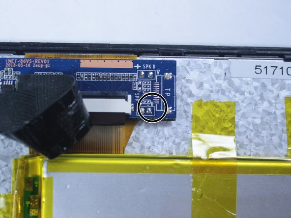 Following the same precautions as with the red wire, solder the black wire to the location noted here.