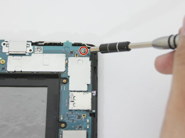 With the Phillips #000  screwdriver, unscrew the four 4.0 mm screw that are holding down the motherboard.