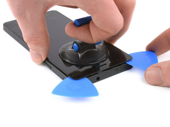 If the glue is hard to loosen, reheat it with your iOpener.