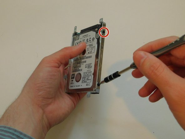 Remove the four 3.0 mm screws that attach the hard drive case to the hard drive using a Philips #1 Screwdriver. If the screwdriver is too big, try #0 sized screwdriver.