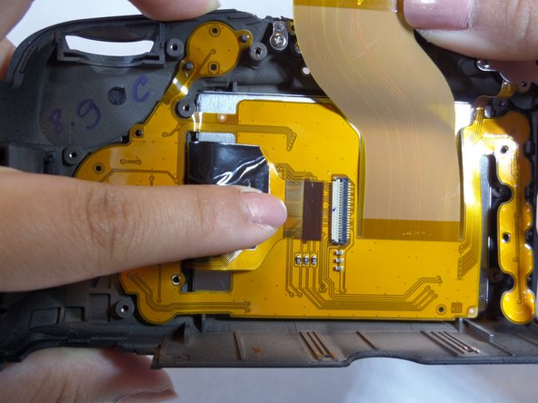 Image 3/3: Flip the white clasp using a plastic opening tool, and pull out the tab.