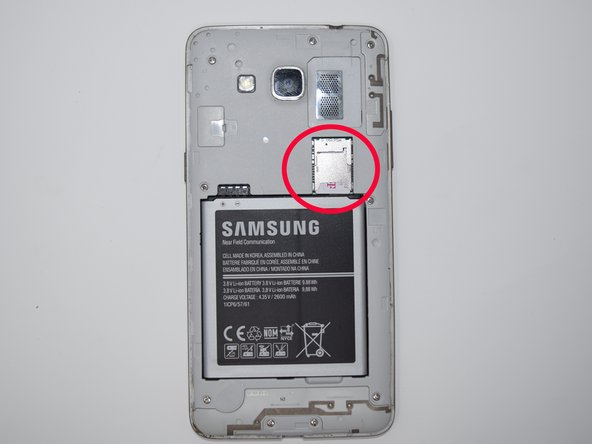 To remove the SD card and Sim card,  look above the battery bay and slide the card out.