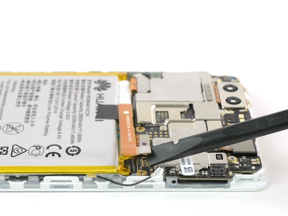 Now you can unplug the battery connector and bend it aside.