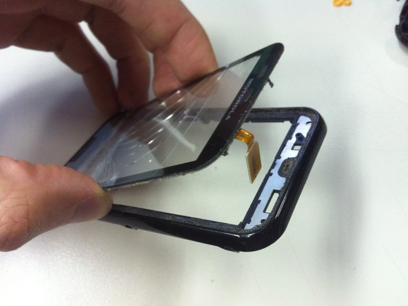 Now, Remove the rest of adhesive from the frame to better apply the new digitizer on it.