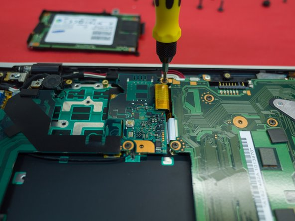 Image 1/3: Remove the plug from the optical board to the motherboard (should pull directly up)