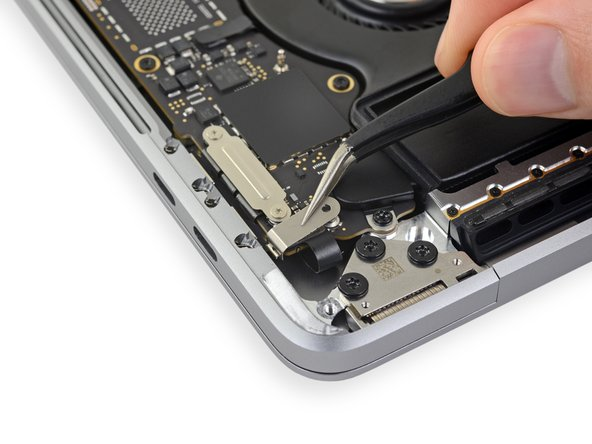 Using your tweezers, slide the bracket toward the side edge of the MacBook Pro until it clears the slotted retaining tab on the logic board.