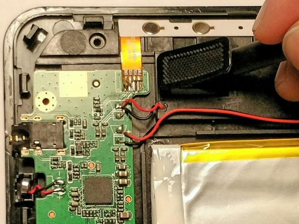 Looking at the front of the speaker, peel back the rectangular cover to expose the speaker.