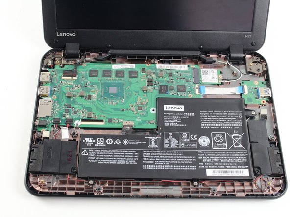 Lift the keyboard up and off the back panel, exposing the motherboard and battery.