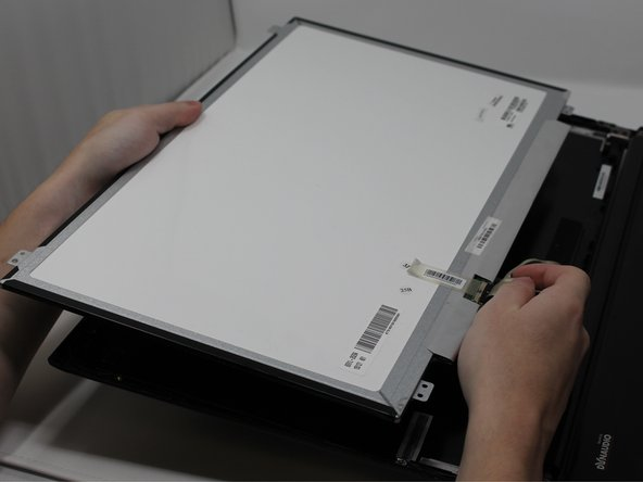When peeling off the tape, fold it back so that it can remain sticky for the new screen.