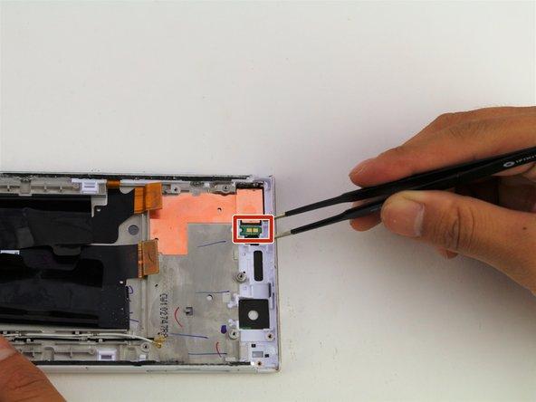 Wedge your flathead tweezers under the flashlight module.