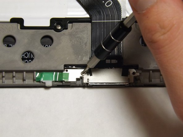Use the Phillips 000 screwdriver to unscrew the two 3mm screws holding the charger port in place.