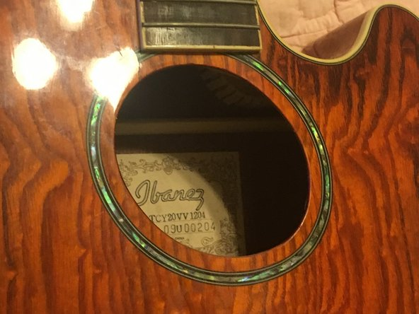 We now have access to the inside of our acoustic-electric guitar.