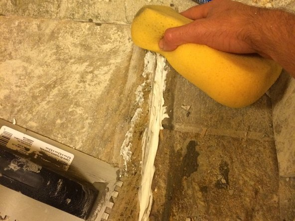 Mix the grout as per manufacturer's instructions. a good mixture will have a thick, pasty feel to it.