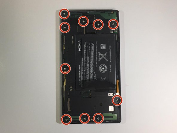 Remove the ten 4mm Torx #4 screws that secure the battery cover to the frame of the phone.