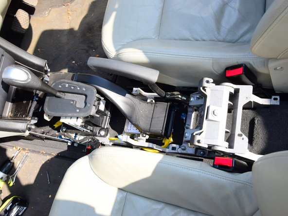 The center console is now loose, and can be puller backwards and upwards, and removed from the car.
