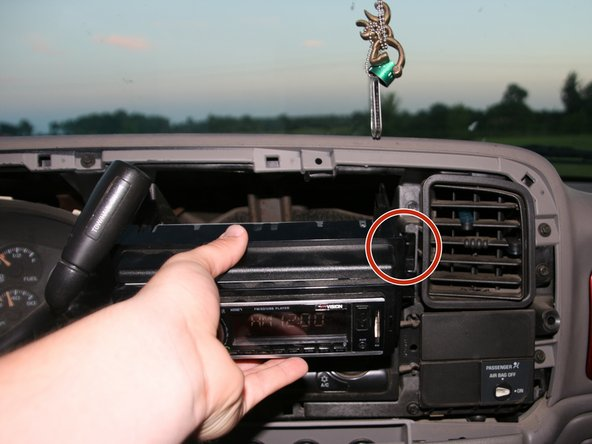 Align the slots along the sides of the new radio with the ones in the dash.
