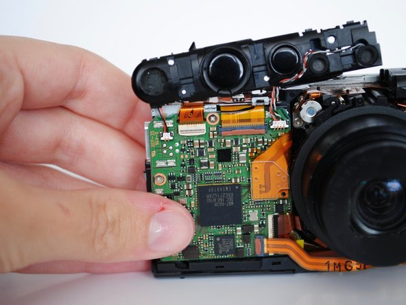 Using your hand, lift and remove the shutter button deck from the top of camera.