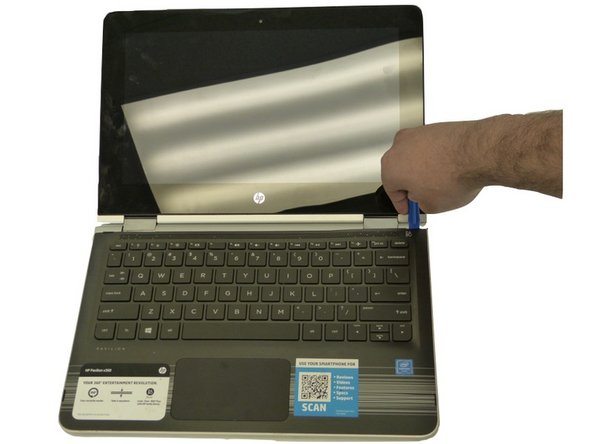 Flip the laptop back over and open it; the keyboard should be facing upwards.