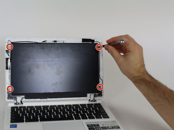 Locate and remove the four 4.2mm screws holding the screen in place by using a Phillips #1 screwdriver.