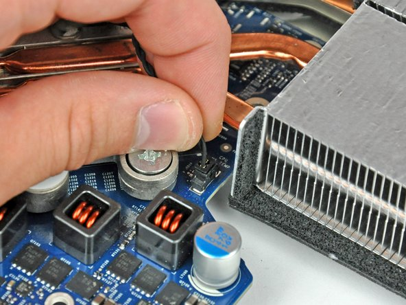 Disconnect the heat sink temperature sensor connector by pulling it straight up from its socket on the logic board.