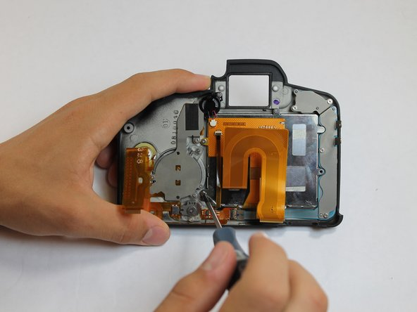 Remove each of the 3.4 mm screws holding in the LCD using a Phillips #0.