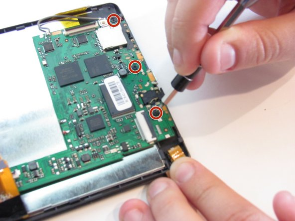 Use Phillips #000 screwdriver to remove  the three 3mm screws on the motherboard.