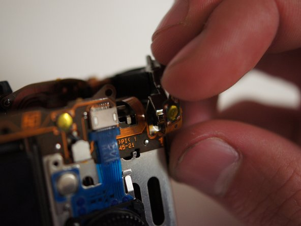 Before pulling off the assembly, fold the rightmost tab of the flexible circuit board away from the metal bracket.