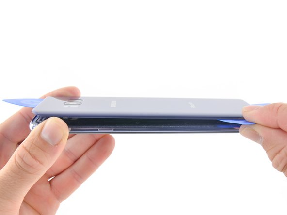 The fingerprint sensor cable connects the phone to the rear glass near the main camera. The cable is very short and should disconnect as the rear glass is removed.