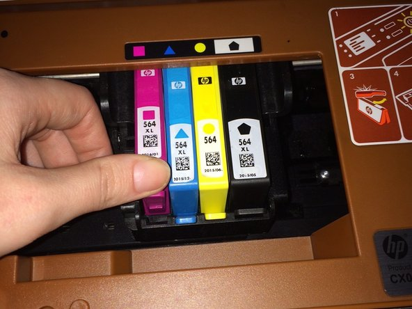 Angle the new ink cartridge to the back and slide it into the slot. Press down gently on the head until you hear a soft click.