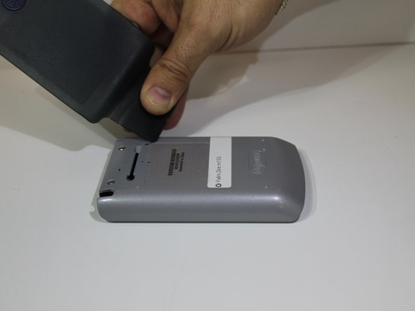 Remove cover, also known as the flap from the Palm Zire m150.