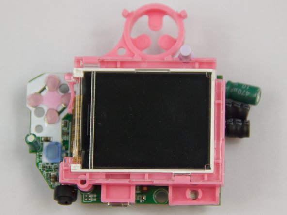 Carefully pull up on the motherboard and pink plastic underneath the motherboard. The pink plastic contains the display and is connected to the motherboard.