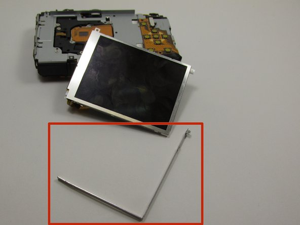 "Then, remove the indicated ""L"" shaped bracket from around the top and right sides of the LCD screen."
