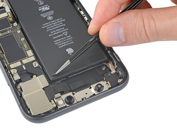 Peel back the three battery adhesive tabs from the top edge of the battery.