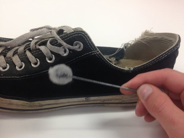 Apply the dye to the faded area of the shoe.