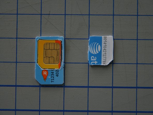 Insert your Micro-SIM Card into the hole you cut out of the SIM.