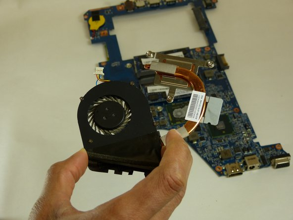 Carefully remove the fan from the motherboard by detaching the plastic insert as seen in the pictures