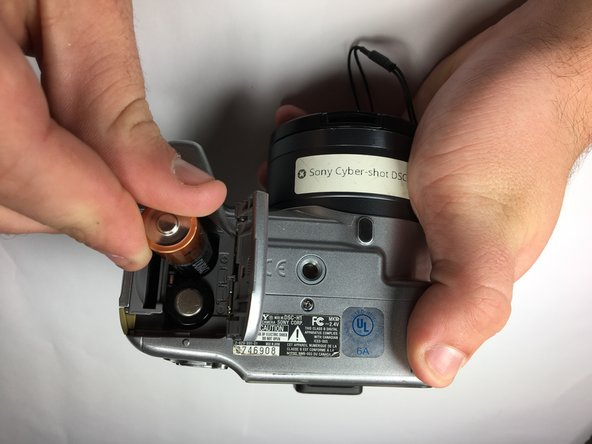 Power down the camera and remove the batteries.