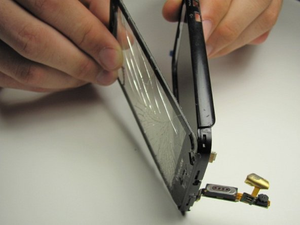 Now that the cable has been removed you can slide it through the opening and detach the glass.