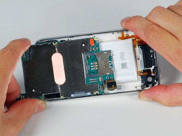 Image 1/1: Slide the logic board towards the dock connector and out of the iPhone.