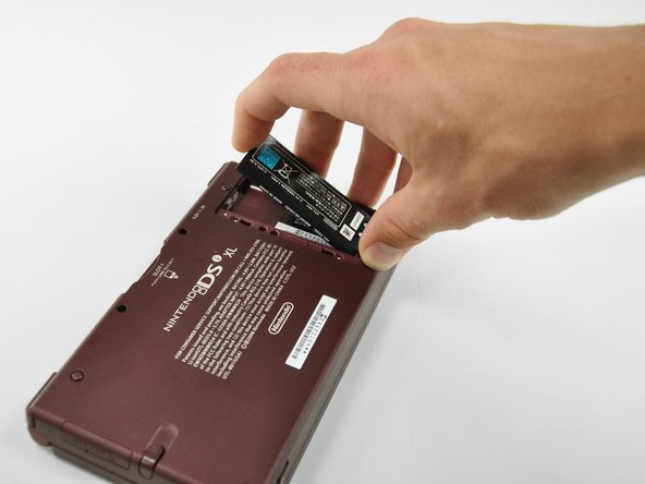 Lift the battery from the DSi XL.