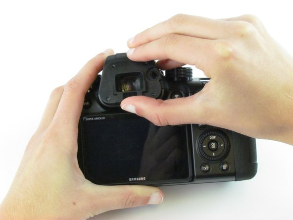Use your fingers to lift the plastic viewfinder cover upward.
