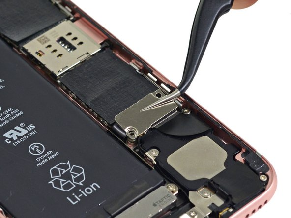 Remove the metal battery connector bracket from the iPhone.