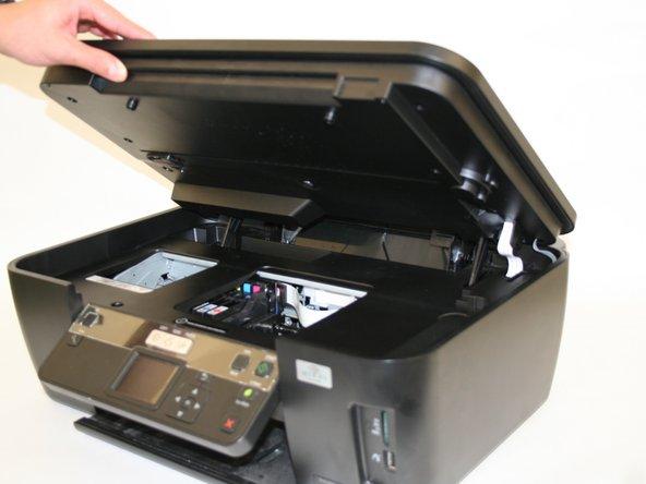Lift the scanning unit.
