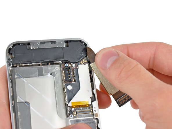 Image 2/2: Do not use excessive force to peel the dock ribbon cable off the logic board. Doing so may tear the cable.