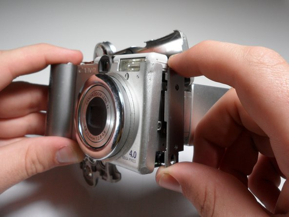 Gently remove the side panel of the camera by pulling it away form the camera.