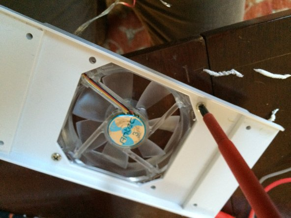 Image 1/1: Note that this is actually a photo of me installing the new fan, the old ones are white.