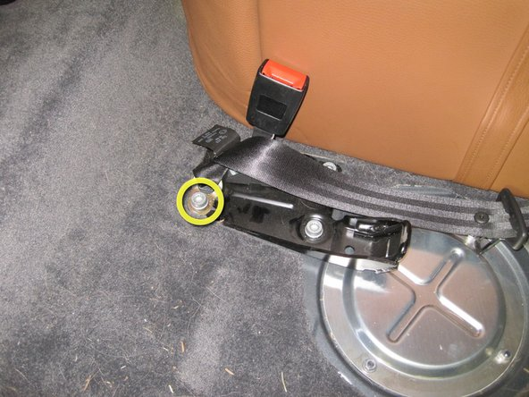 Image 3/3: The center seatbelt is attached to the floor.  You need to remove the 10mm triple square bolt before the seat can be removed from the vehicle.