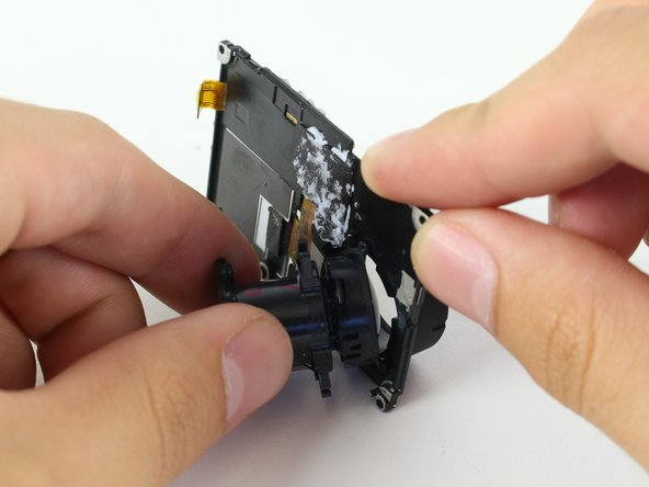 Carefully remove the camera lens from the LCD Housing.