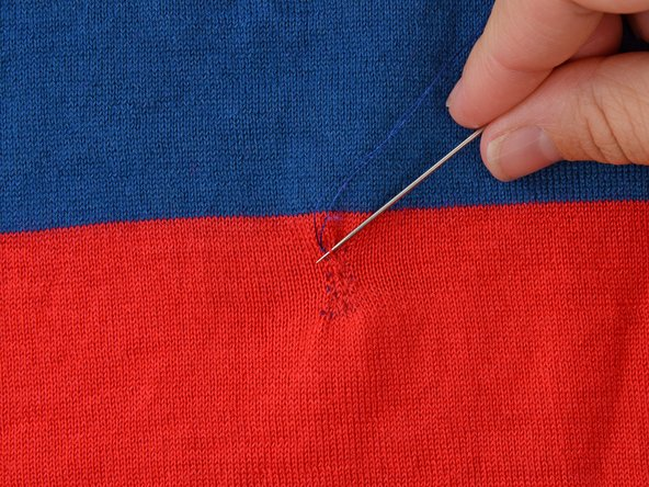You will begin to stitch over your previous stitches at a forty-five degree angle, just as before. Remember to only stitch through one layer of the garment.